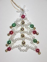 this beaded christmas tree craft make a cute ornament or decoration for your presents while this little creation has been created in green to help set it - Beaded Christmas Tree Decorations To Make
